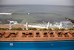 """The Galle Face Hotel's legendary pool facing seawards. Founded in Colombo, Sri Lanka in 1864, is the oldest hotel east of Suez. It is located off Galle Road, the main highway in the City of Colombo.The hotel borrowed its name from this charming way back of """"Galle Face Green"""" in 1864, built by four British entrepreneurs who were looking to start a business in the city..Mignonne Fernando and The Jetliners regularly entertained guests at the Coconut Grove, the night club attached to the hotel. The venue was even popularised in a song. Radio Ceylon recorded music programmes from the Coconut Grove as well as the Galle Face Hotel itself, presented by some of the legendary Radio Ceylon announcers in the 1950s and 1960s, such as Livy Wijemanne and Vernon Corea. Thousands listened to the broadcasts, particularly 'New Year's Eve' dances from the Galle Face Hotel..D.G. William (known as 'Galle Face William'), the Lanka Sama Samaja Party trade union leader, first worked and organised workers here. The Science fiction author Arthur C. Clarke wrote the final chapters of 3001 - The Final Odyssey in the hotel..It regularly featured on the itineraries of royalty . Princess Alexandra of Denmark commented that 'the peacefulness and generosity encountered at the Galle Face Hotel cannot be matched'. Former guests include the first man in space, Yuri Gagarin, former British Prime minister Edward Heath, the journalist Eric Ellis and Prince Sadruddhin Aga Khan, Rigger Bone Sconi, Lord Louis Mountbatten, 1st Earl Mountbatten of Burma and Marshal Josip Broz Tito."""