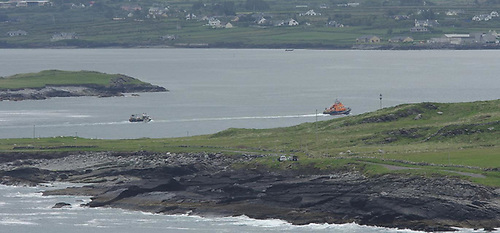 The Valentia RNLI lifeboat towing the fishing vessel to Valentia Marina