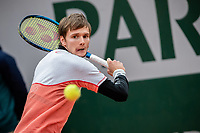 28th September 2020, Roland Garros, Paris, France; French Open tennis, Roland Garros 2020; Alexander Bublik returns a shot during the mens singles first round match with Gael Monfils of France