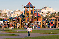 Tripoli, Libya, North Africa - Friday Afternoon in the Public Park, Playground, near the Green Square.  Children on Slide, Girl Running.