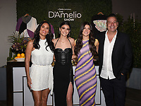 """LOS ANGELES - SEPT 2: (L-R) Heidi D'Amelio, Dixie D'Amelio, Charli D'Amelio, and Marc D'Amelio attend a screening of Hulu's """"The D'Amelio Show"""" at NeueHouse Rooftop Hollywood on September 2, 2021 in Los Angeles, California. (Photo by Frank Micelotta/Hulu/PictureGroup)"""