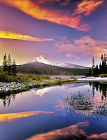 Mount Washington reflection in Big Lake with snow and sunset. Oregon.