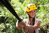 Woman about to repell while Ziplining on the Big island with Kohala zipline