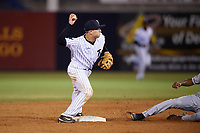 Tampa Yankees second baseman Nick Solak (39) throws to first base as Jose Azocar slides in during a game against the Lakeland Flying Tigers on April 7, 2017 at George M. Steinbrenner Field in Tampa, Florida.  Lakeland defeated Tampa 5-0.  (Mike Janes/Four Seam Images)