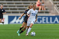 BRIDGEVIEW, IL - JULY 18: Jessica Fishlock #10 of the OL Reign dribbles the ball during a game between OL Reign and Chicago Red Stars at SeatGeek Stadium on July 18, 2021 in Bridgeview, Illinois.