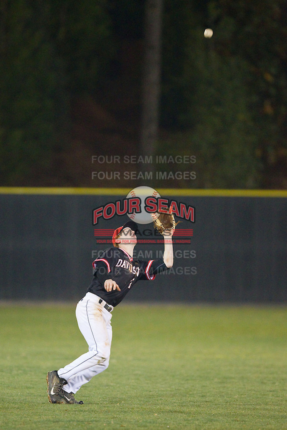 Davidson Wildcats shortstop Sam Foy (2) settles under a fly ball in shallow left field for the final out of the game against the Wake Forest Demon Deacons at Wilson Field on March 19, 2014 in Davidson, North Carolina.  The Wildcats defeated the Demon Deacons 7-6.  (Brian Westerholt/Four Seam Images)