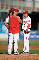 Harrisburg Senators pitching coach Chris Michalak talks with starting pitcher Jaron Long (5) and catcher Raudy Read (26) during a game against the Bowie Baysox on May 16, 2017 at FNB Field in Harrisburg, Pennsylvania.  Bowie defeated Harrisburg 6-4.  (Mike Janes/Four Seam Images)