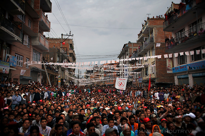 A crowd of supporters listens to Maoist leader Pushpa Kamal Dahal, who goes by the nom de guerre Prachanda,  as he speaks at a campaign rally in Kirtipur on the outskirts of Kathmandu, Nepal on 6 April, 2008.