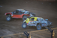 Dec. 10, 2011; Chandler, AZ, USA;  LOORRS pro 2 unlimited driver Myan Spaccarelli !2 and Rob Naughton (54) during round 15 at Firebird International Raceway. Mandatory Credit: Mark J. Rebilas-