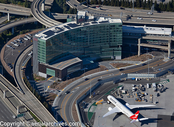 aerial photograph of a Quantas airlines Boeing 787 Dreamliner parked in front of the Grand Hyatt Hotel at San Francisco International airport (SFO), San Francisco, California