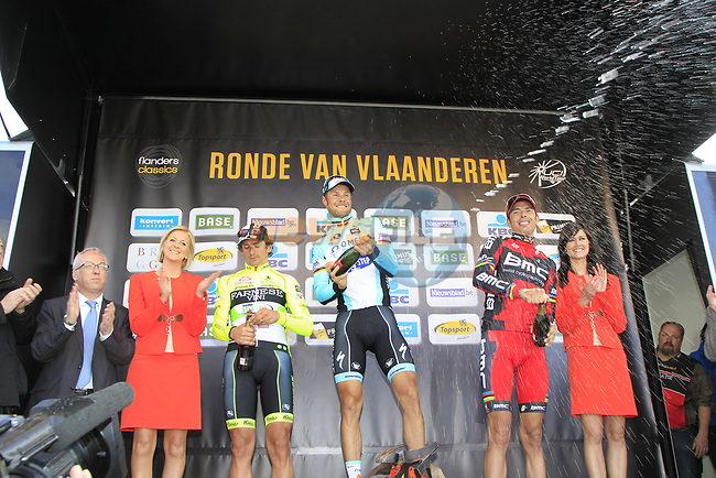 Tom Boonen (BEL) Omega Pharma-Quickstep wins with Filippo Pozzato Farnese Vini-Selle Italia in 2nd place and Alessandro Ballan (ITA) BMC Racing Team 3rd on the podium at the end of the 96th edition of The Tour of Flanders 2012 , running 256.9km from Bruges to Oudenaarde, Belgium. 1st April 2012. <br /> (Photo by Eoin Clarke/NEWSFILE).