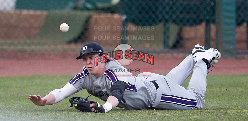 Jack Mitchell (7) of the Northwestern Wildcats fails to make a diving catch in left field during a game against the Missouri State Bears at Hammons Field on March 9, 2013 in Springfield, Missouri. (David Welker/Four Seam Images)