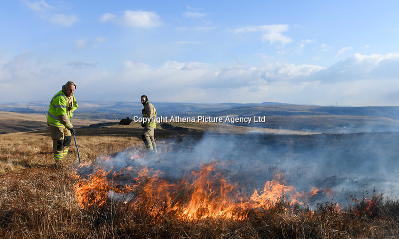 A huge wildfire burns above the villages of Ammanford and Garnant, on the Black Mountain in South Wales, UK. The blaze covers a huge area and is being fueled by strong easterly winds, pushing the flames close to farms and rural properties. Fire fighters from local stations are battling to keep the fire at a safe distance and limit any dangers. Tuesday 27 February 2018