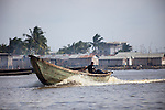 Fishermen ply the waters along Benin's coast, such as here in the capital city of Cotonou.