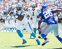 The Carolina Panthers played the New York Giants at Bank of America Stadium in Charlotte, NC.  The Panthers won 38-0 for their first victory of the season.  The Giants dropped to 0-3.  Carolina Panthers fullback Mike Tolbert (35), New York Giants strong safety Antrel Rolle (26)