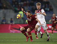 Football, Serie A: AS Roma - Bologna FC, Olympic stadium, Rome, February 18, 2019. <br /> Roma's Edin Dzeko (l) in action with Bologna's Filip Helander (r) during the Italian Serie A football match between AS Roma and Bologna FC at Olympic stadium in Rome, on February 18, 2019.<br /> UPDATE IMAGES PRESS/Isabella Bonotto