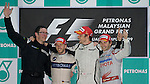 05 Apr 2009, Kuala Lumpur, Malaysia ---   Brawn GP Formula One Team driver Jenson Button (2nd right) of Great Britain celebrates on the podium with his Race Engineer Andy Shovlin (left), second placed Nick Heidfeld (2nd left) of Germany and BMW Sauber and third placed Timo Glock (right) of Germany and Toyota after winning the rain curtailed the 2009 Fia Formula One Malasyan Grand Prix at the Sepang circuit near Kuala Lumpur. Photo by Victor Fraile --- Image by © Victor Fraile / The Power of Sport Images