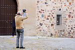 A man is taking a photo of Caceres Cathedral during the first day of liftning of the confinement restrictions in Caceres, Extremadura. 02 May 2020(Alterphotos/Francis Gonzalez)