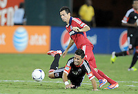 D.C. United midfielder Marcelo Saragosa (11) gets fouled from Chicago Fire Marco Pappa (16) D.C. United defeated The Chicago Fire 4-2 at RFK Stadium, Wednesday August 22, 2012.
