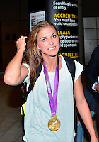 August 09, 2012: Alex Morgan on her way to the team bus at the conslucion of women's Football Final match at the Wembley Stadium on day thirteen in Wembley, England. USA defeat Japan 2-1 to win it's third consecutive Olympic gold medal in women's soccer. ..