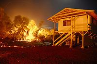 Full moon, Lava by Gary Sleik's house, Lava flow in the trees and a section of highway 137, Near Hawaii, USA Volcanoes National Park, Kalapana, Hawaii, USA, The Big Island of Hawaii, USA