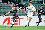Joao Pereira of SC Kitchee (L) is chased by Auckland City Midfielder Fabrizio Tavano (R) during the Nike Lunar New Year Cup 2017 match between SC Kitchee (HKG) and Auckland City FC (NZL) on January 31, 2017 in Hong Kong, Hong Kong. Photo by Marcio Rodrigo Machado / Power Sport Images