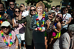 © Joel Goodman - 07973 332324 - all rights reserved . 24/08/2019. Manchester, UK. Members of the watching crowd with a Cilla Black cutout . The 2019 Manchester Gay Pride parade through the city centre , with a Space and Science Fiction theme . Manchester's Gay Pride festival , which is the largest of its type in Europe , celebrates LGBTQ+ life . Photo credit: Joel Goodman/LNP