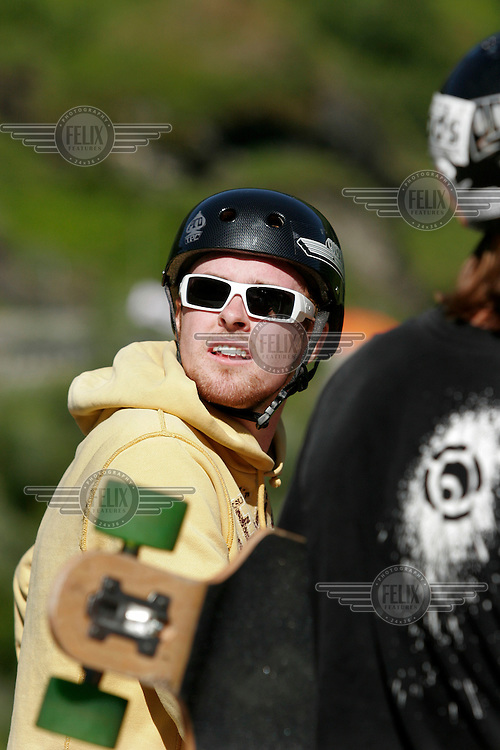 Jørgen Stokke Halvorsen sporting helmet and fashionable eyewear. The first ever Norwegian Longboarding Championship was held during the Extreme Sport Week, an annual event that draws adrenalin junkies to the small Norwegian mountain town of Voss. © Fredrik Naumann