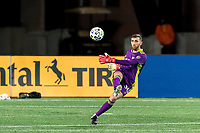 FOXBOROUGH, MA - OCTOBER 7: Matt Turner #30 of New England Revolution clears the ball during a game between Toronto FC and New England Revolution at Gillette Stadium on October 7, 2020 in Foxborough, Massachusetts.