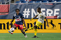 FOXBOROUGH, MA - MAY 16: Harrison Afful #25 Columbus SC crosses the ball towards the New England Revolution goal during a game between Columbus SC and New England Revolution at Gillette Stadium on May 16, 2021 in Foxborough, Massachusetts.