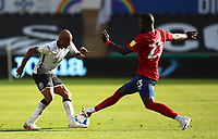17th October 2020; Liberty Stadium, Swansea, Glamorgan, Wales; English Football League Championship Football, Swansea City versus Huddersfield Town; Andre Ayew of Swansea City is tackled by Mouhamadou-Naby Sarr of Huddersfield Town