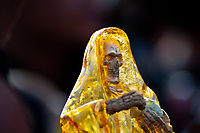 A figurine of Santa Muerte (Saint Death) is seen during a religious pilgrimage in Tepito, a rough district of Mexico City, Mexico, 1 June 2011. The religious cult of Santa Muerte is a syncretic fusion of Aztec death worship rituals and Catholic beliefs. Born in lower-class neighborhoods of Mexico City, it has always been closely associated with crime. In the past decades, original Santa Muerte's followers (such as prostitutes, pickpockets and street drug traffickers) have merged with thousands of ordinary Mexican Catholics. The Saint Death veneration, offering a spiritual way out of hardship in the modern society, has rapidly expanded. Although the Catholic Church considers the Santa Muerte's followers as devil worshippers, on the first day of every month, crowds of believers in Saint Death fill the streets of Tepito. Holding skeletal figurines of Holy Death clothed in a long robe, they pray for power healing, protection and favors and make petitions to 'La Santísima Muerte', who reputedly can make life-saving miracles.