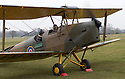 """13/03/15<br /> <br /> Warming up the engine before first take-off.<br /> <br /> ***FULL STORY HERE:   http://www.fstoppress.com/articles/tiger-moth-restorations/    ****<br /> <br /> You may remember spending hours toiling over Airfix models, painstakingly following intricate instructions and trying not to glue your fingers together before painting your own miniature version of one of the RAF's or Luftwaffe's finest aircraft. Then spare a thought for one man who has just helped to restore and put together one World War Two Tiger Moth and is about to start piecing together another FOUR aircraft that were discovered in bits in a barn.<br /> <br /> Sixty-year-old Colin Temple-Smith – who wears a moustache that any Wing Commander would be proud of – has spent a lifetime restoring vintage cars and motorcycles and recently quit his job as a window fitter to help re-build the five bi-planes that will become part of a growing fleet of Tiger Moths at Derbyshire based Blue Eye Aviation.<br /> <br /> Today saw the first of the fully-restored five aircraft take to the skies.<br /> <br /> """"It's just like working on old bikes and cars, although they're a lot more fragile"""" explained Colin, whose wife runs the Aviators Café at Darley Moor Airfield near Ashbourne.<br /> <br /> """"When I was a teenager I used to be a member of a modelling club, making flying models from wood and canvas. They're very similar to build – it's really just the size that's changed with these.<br /> <br /> All Rights Reserved: F Stop Press Ltd. +44(0)1335 418629   www.fstoppress.com."""