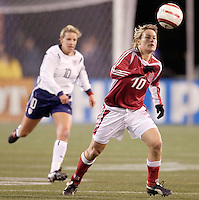 """Denmark's Anne Dot Eggers is followed by Aly Wagner of the USA. The US Women's National Team tied the Denmark Women's National Team 1 to 1 during game 8 of the 10 game the """"Fan Celebration Tour"""" at Giant's Stadium, East Rutherford, NJ, on Wednesday, November 3, 2004.."""