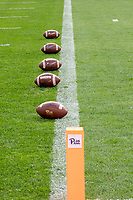 Pitt footballs are lined up on the goalline awaiting quarterbacks' pregame throws. The Virginia Cavaliers defeated the Pitt Panthers 30-14 in a football game at Heinz Field, Pittsburgh, Pennsylvania on August 31, 2019.