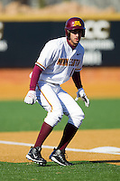 Justin Gominsky #18 of the Minnesota Golden Gophers takes his lead off of third base against the Towson Tigers at Gene Hooks Field on February 26, 2011 in Winston-Salem, North Carolina.  The Gophers defeated the Tigers 6-4.  Photo by Brian Westerholt / Sports On Film