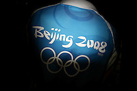CHINA. Beijing. A volunteer in the Olympic village during the Beijing 2008 Summer Olympics. 2008