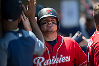 Tacoma Rainiers first baseman Daniel Vogelbach (23) is congratulated by teammates during a Pacific Coast League game against the Sacramento RiverCats at Raley Field on May 15, 2018 in Sacramento, California. Tacoma defeated Sacramento 8-5. (Zachary Lucy/Four Seam Images)