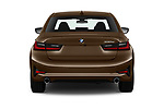 Straight rear view of a 2019 BMW 3 Series Sport PHEV 4 Door Sedan stock images