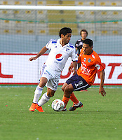 TRUJILLO- PERU - 28-08-2014: Juan Morales (Der.) jugador de Universidad Cesar Vallejo de Peru, disputa el balón con Fabian Vargas (Izq.) jugador Millonarios de Colombia durante partido de vuelta entre Universidad Cesar Vallejo de Peru y Millonarios de Colombia de la primera  fase, llave 14 de la Copa Total Suramericana en el estadio Mansiche, de, de la ciudad de Trujillo.  / Juan Morales (R) player Universidad Cesar Vallejo of Peru, vies for the ball with Fabian Vargas (L) player of Millonarios of Colombia, during a match of the second leg between Universidad Cesar Vallejo of Peru and Millonarios of Colombia for the first phase, key 14 of the Copa Total Suramericana in the Mansiche stadium in Trujillo city. Photos: Diario Libero / Photogamma / VizzorImage.