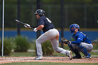 New York Yankees Brandon Thomas (66) at bat in front of catcher Dan Jansen (16) during a minor league spring training game against the Toronto Blue Jays on March 24, 2015 at the Englebert Complex in Dunedin, Florida.  (Mike Janes/Four Seam Images)