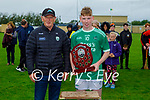 Ballyduff captain Aodhan Curley accepts the Co Minor League trophy from Paudie Dineen, Hurling Officer of the Kerry Co Comm