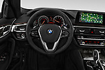 Car pictures of steering wheel view of a 2018 BMW 5 Series Sport 4 Door Sedan