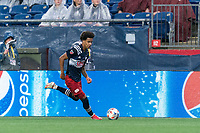 FOXBOROUGH, MA - AUGUST 4: Tajon Buchanan #17 of New England Revolution dribbles down the wing during a game between Nashville SC and New England Revolution at Gillette Stadium on August 4, 2021 in Foxborough, Massachusetts.