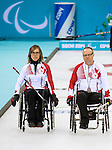 Sochi, RUSSIA - Mar 13 2014 - Sonja Gaudet, and Dennis Thiessen as Canada takes on Slovakia in round robin play at the 2014 Paralympic Winter Games in Sochi, Russia.  (Photo: Matthew Murnaghan/Canadian Paralympic Committee)