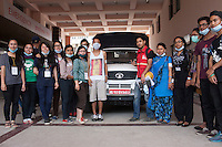 """Volunteers from """"I to WE"""" poses for a group photo in a hospital at Kathmandu, Nepal. May 05, 2015"""
