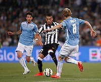 Calcio, finale Tim Cup: Juventus vs Lazio. Roma, stadio Olimpico, 20 maggio 2015.<br /> Juventus' Roberto Pereyra, center, is challenged by Lazio's Dusan Basta, right, during the Italian Cup final football match between Juventus and Lazio at Rome's Olympic stadium, 20 May 2015.<br /> UPDATE IMAGES PRESS/Isabella Bonotto