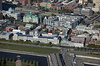 aerial photograph of the Saint Lawrence river waterfront, Montreal, Quebec.  The foreground includes the Bonsecours Market (Marché Bonsecours).  Montreal City Hall  is visible behind the market | photographie aérienne des berges du fleuve Saint-Laurent, Montréal, Québec.  Au premier plan, on aperçoit le Marché Bonsecours.  L'hôtel de ville de Montréal est visible derrière le marché.