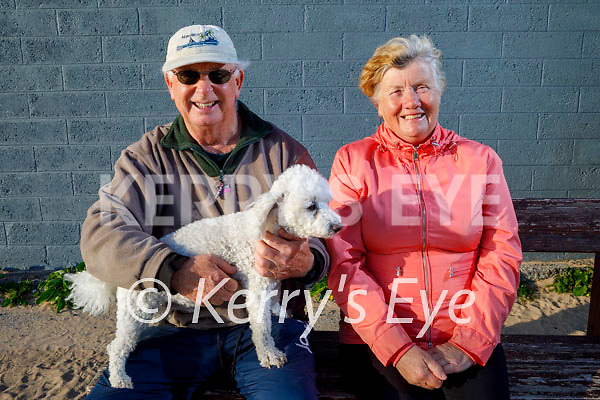 Enjoying a stroll in Fenit on Thursday, l to r: Eddie Stack and his dog Bawnie and Kate Reidy.