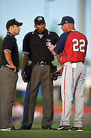 Hagerstown Suns manager Patrick Anderson (22) argues a call with umpires Grant Conrad and Edwin Moscoso (center) during a game against the Lexington Legends on May 22, 2015 at Whitaker Bank Ballpark in Lexington, Kentucky.  Lexington defeated Hagerstown 5-1.  (Mike Janes/Four Seam Images)